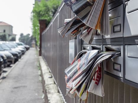 Crowded mailbox during vacation